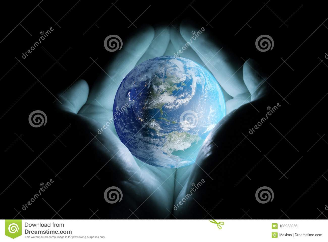 Men`s hands holding the planet earth with a blue glow on a black background.