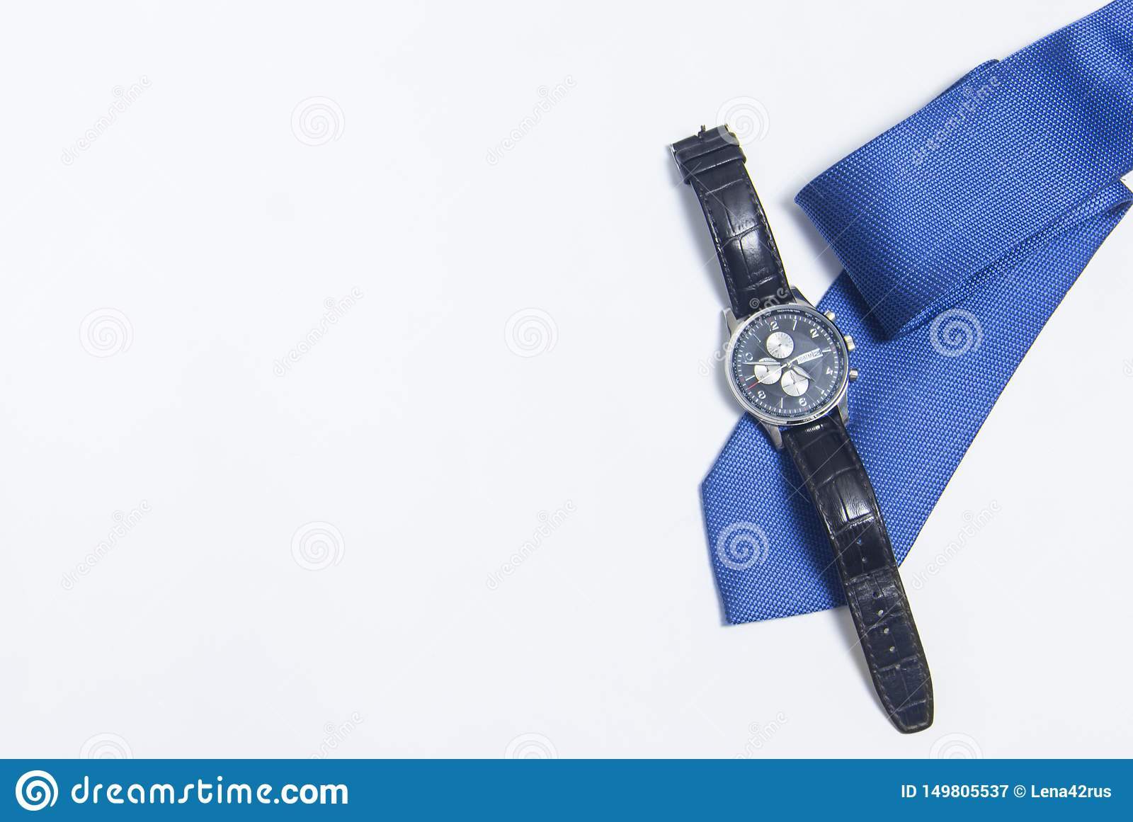 Men`s watch and tie on white background. Men`s accessories on white background