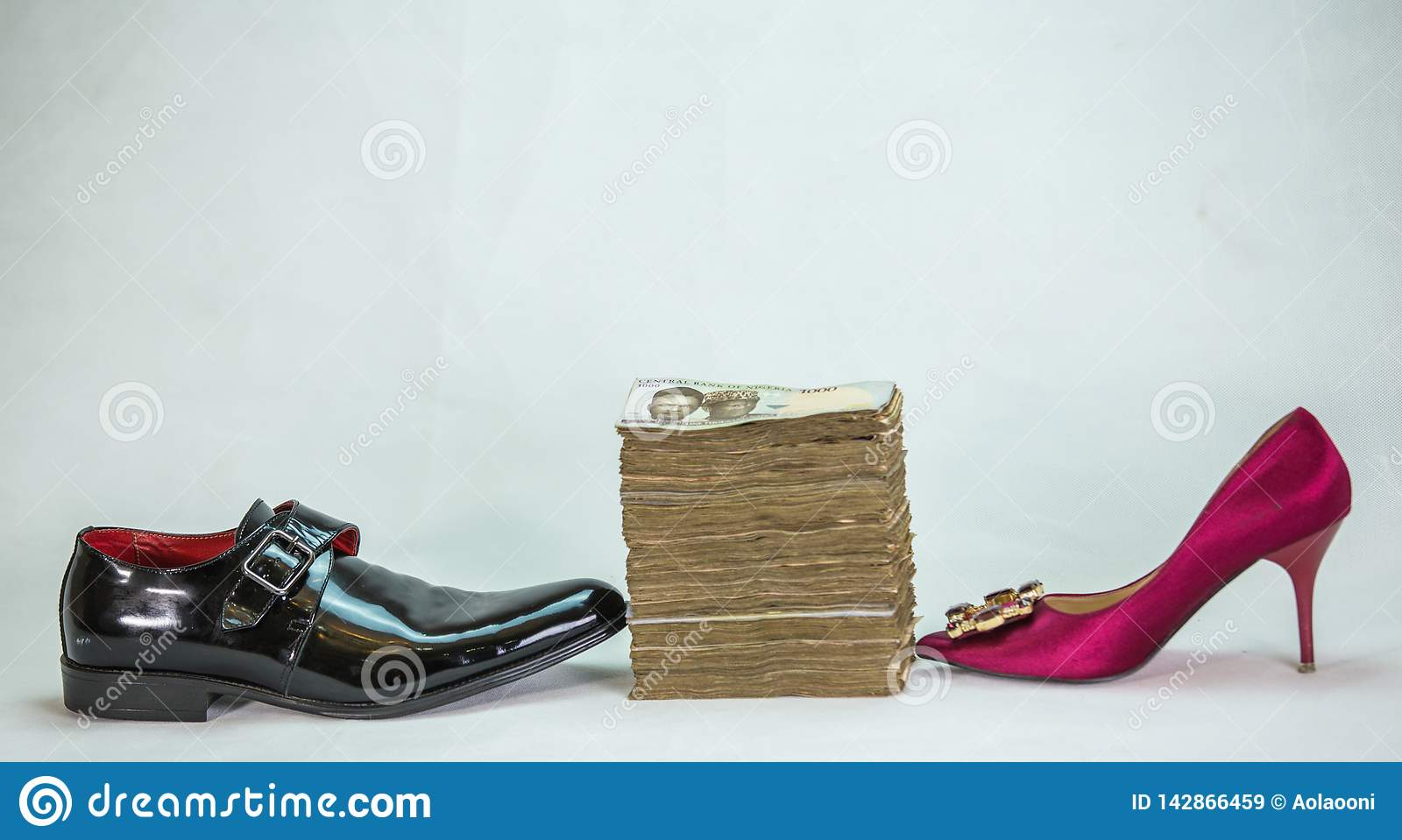 Men shoe and women shoe with bundle of naira notes local currencies cash