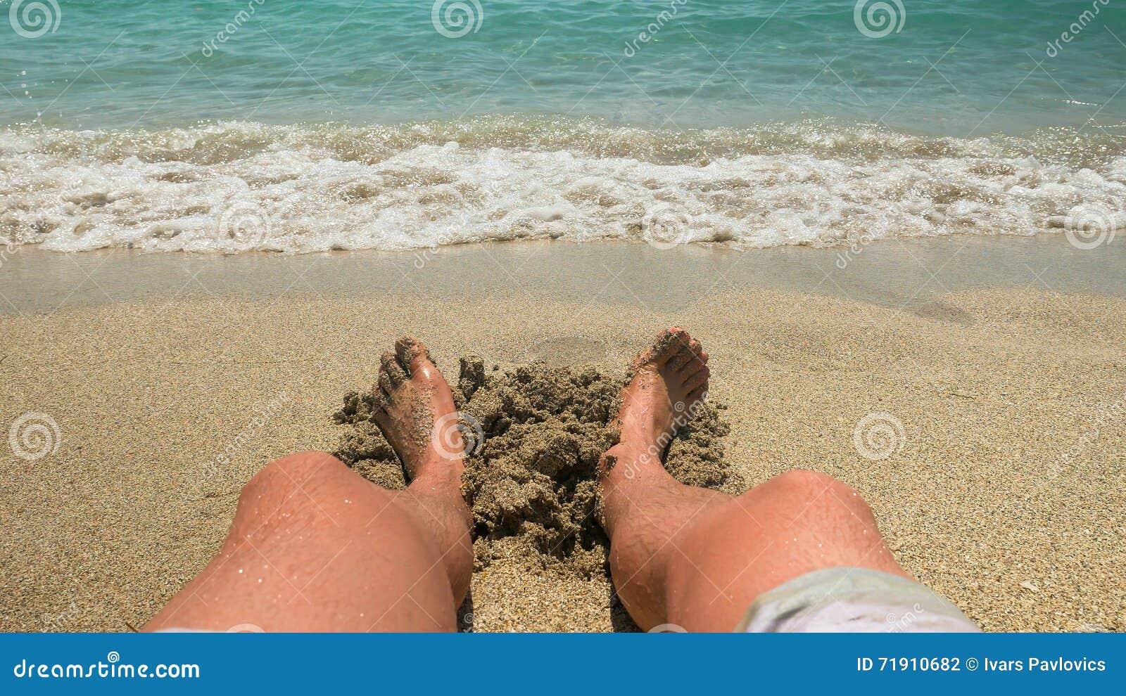 Men sitting in beach