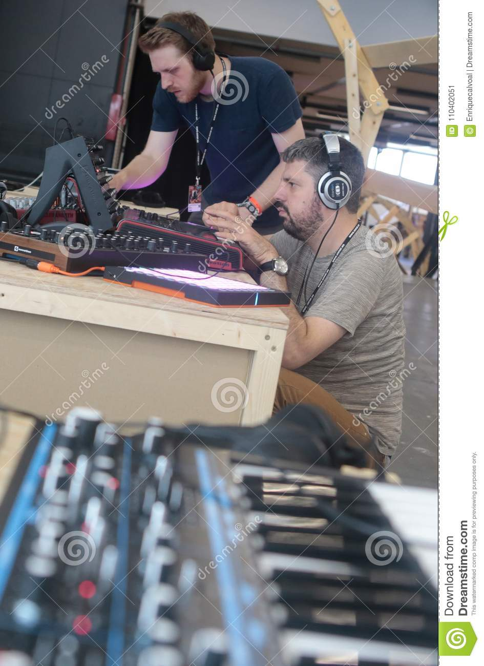 Men Using Music Synthesizer Mixing System At Sonar Festival Vertical