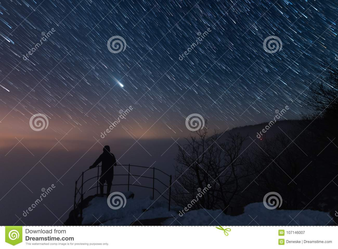 Men is on the viewpoint, under the startrail