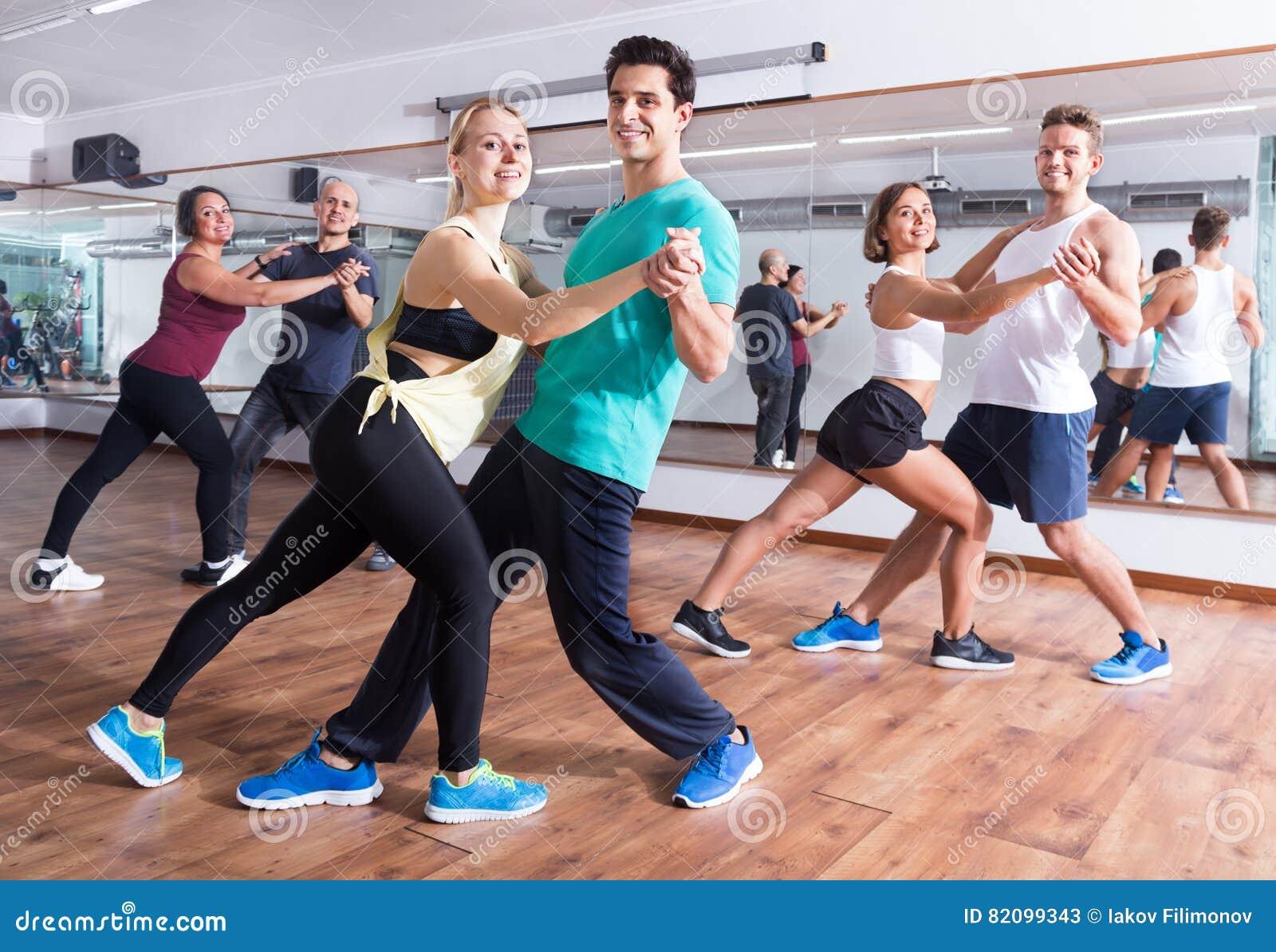Men and women dancing salsa o bachata