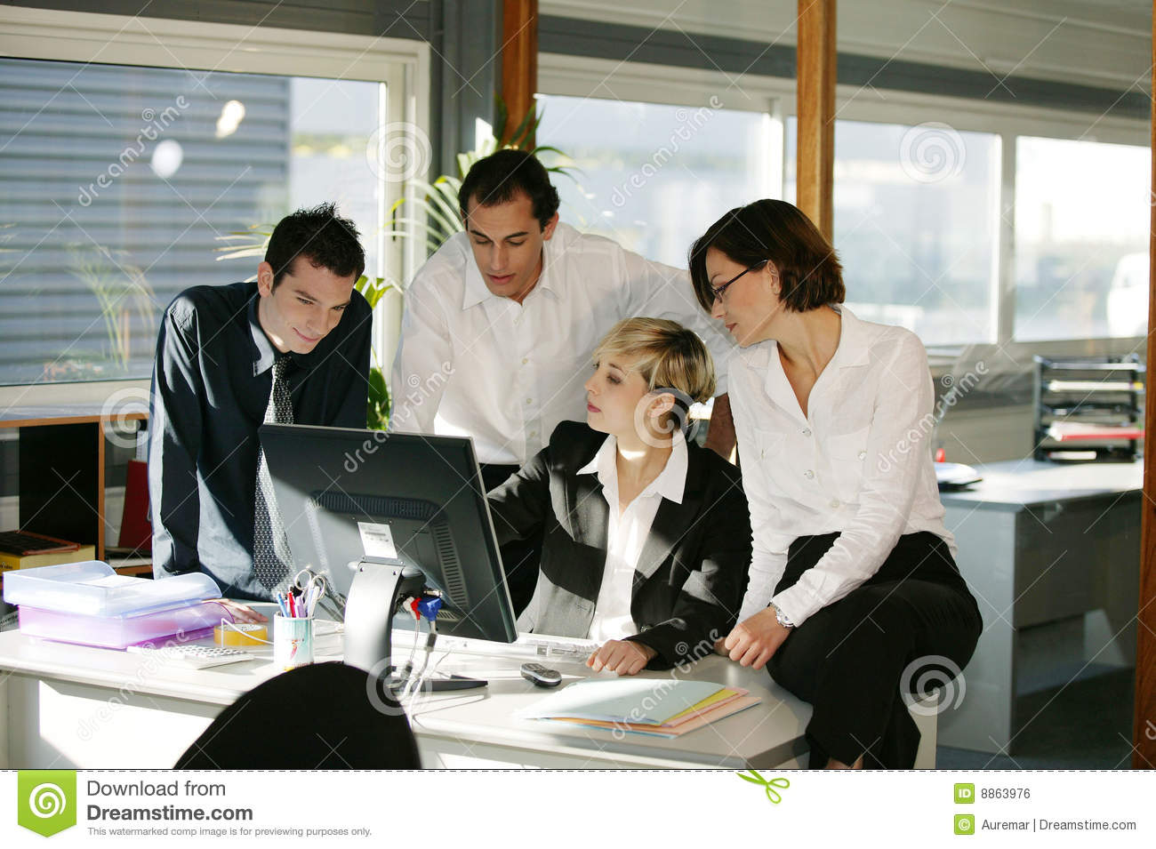 Men and women at desk with computer