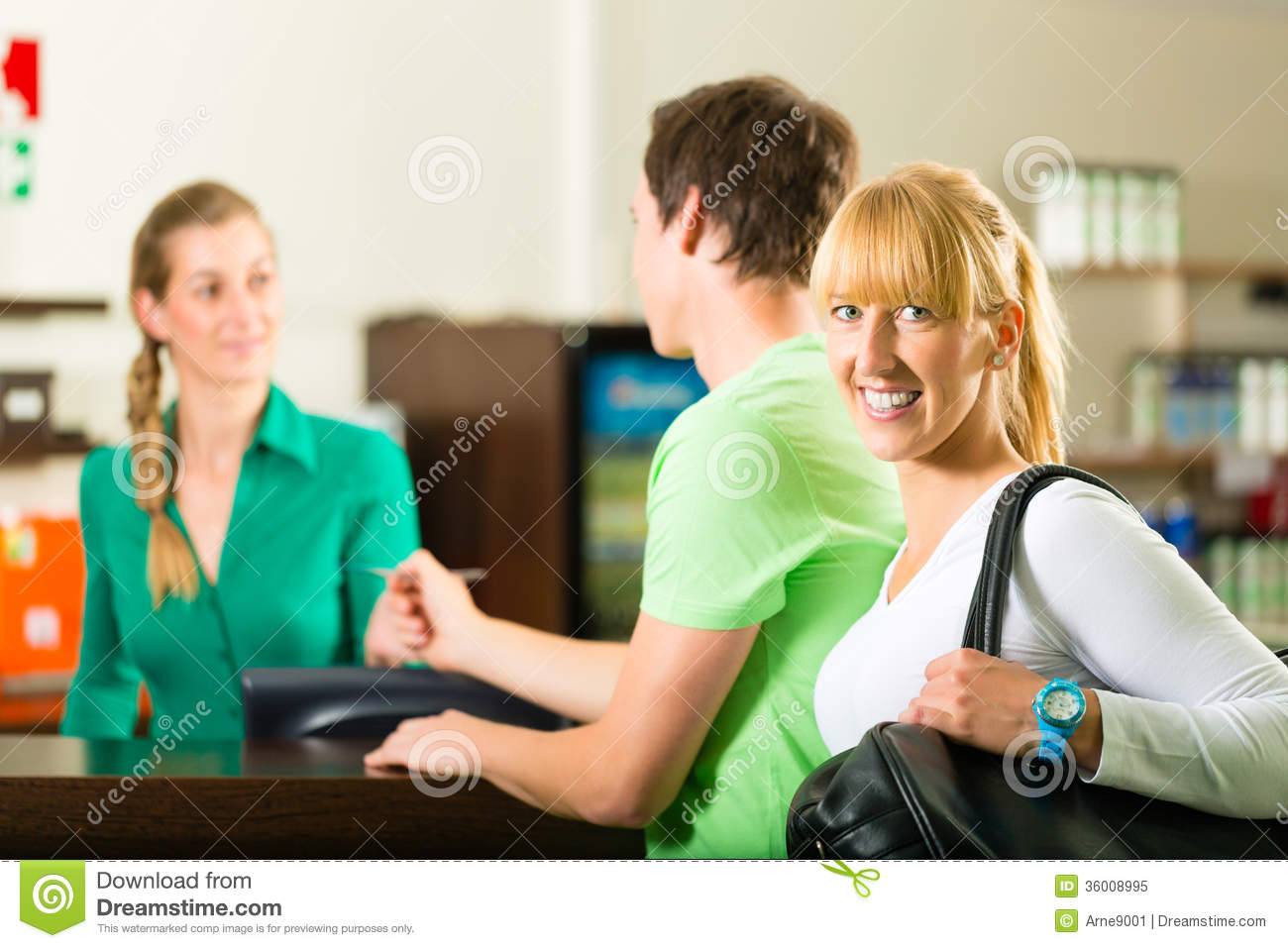 receptionist on phone in clinic royalty stock images image men and women sign up at gym reception royalty stock photo