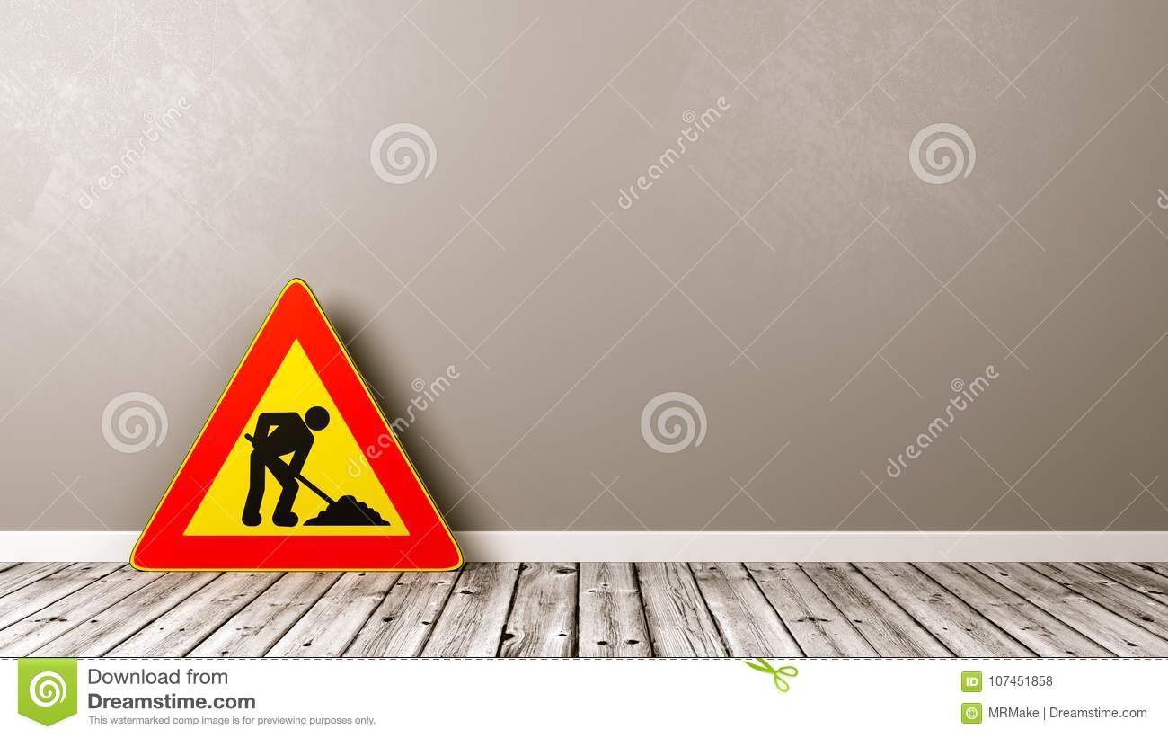 Men at Work Triangle Road-Sign on Wooden Floor