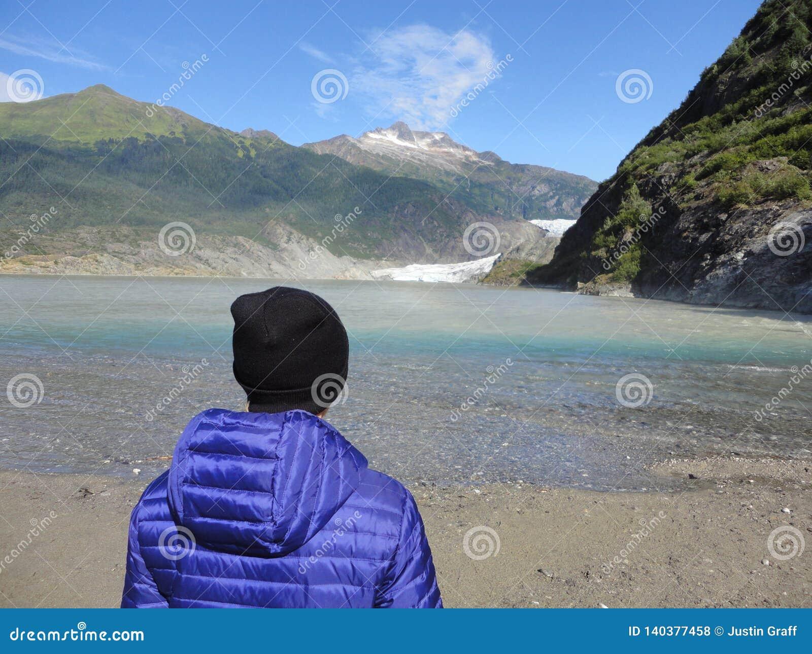 Mendenhall Glacier Juneau Alaska. Mendenhall Glacier flowing into Mendenhall Lake in between mountains with Nugget falls. Perfect