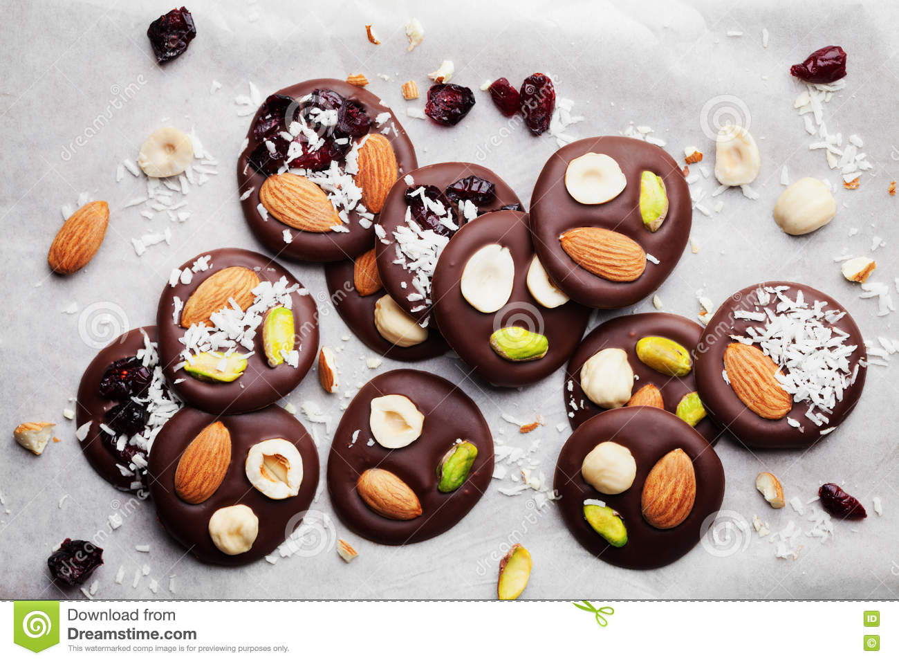 mendiant traditional french chocolate candy for christmas holiday from above homemade dessert with nuts and