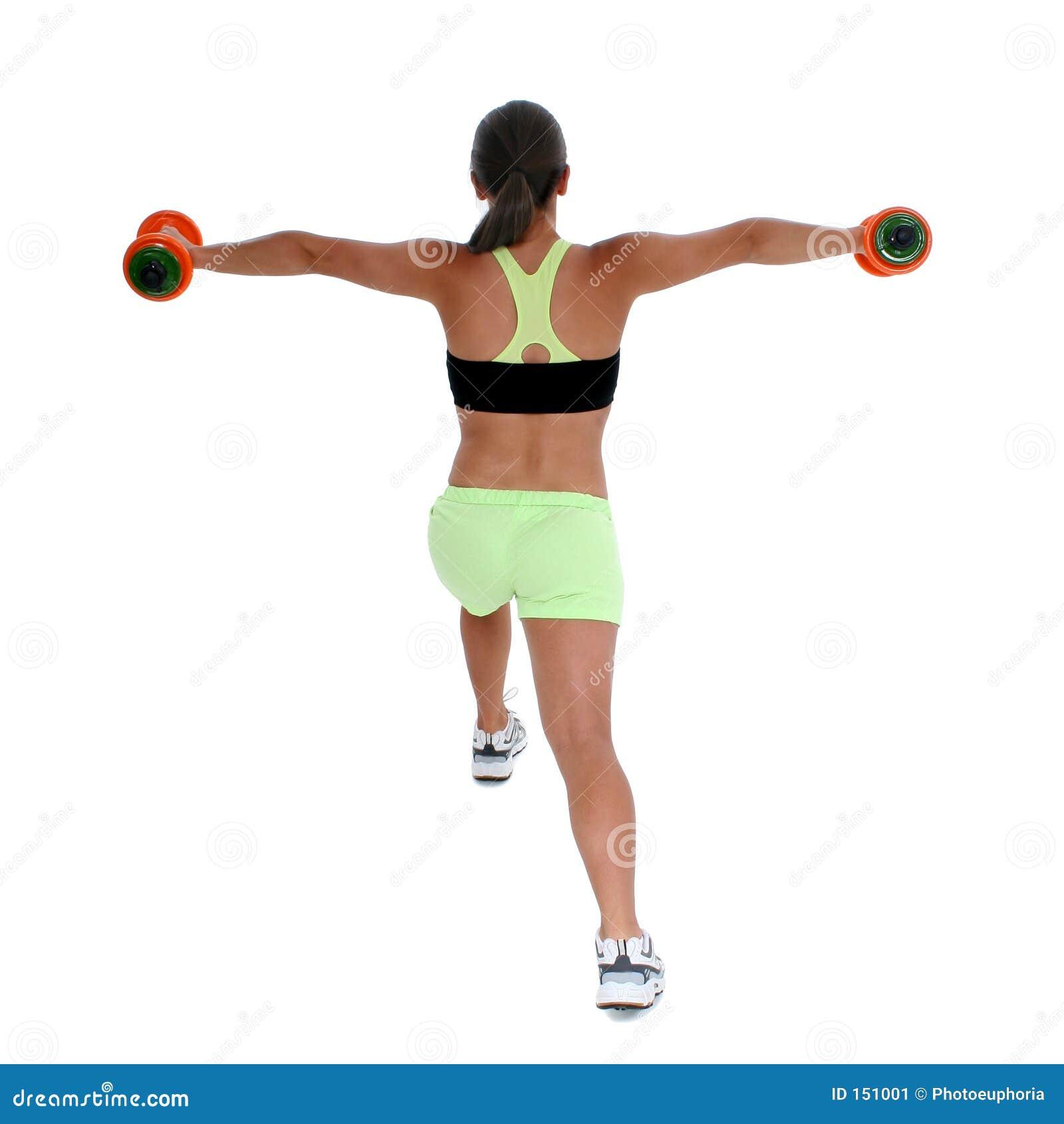 Menina adolescente bonita na roupa do exercício que demonstra o Lunge