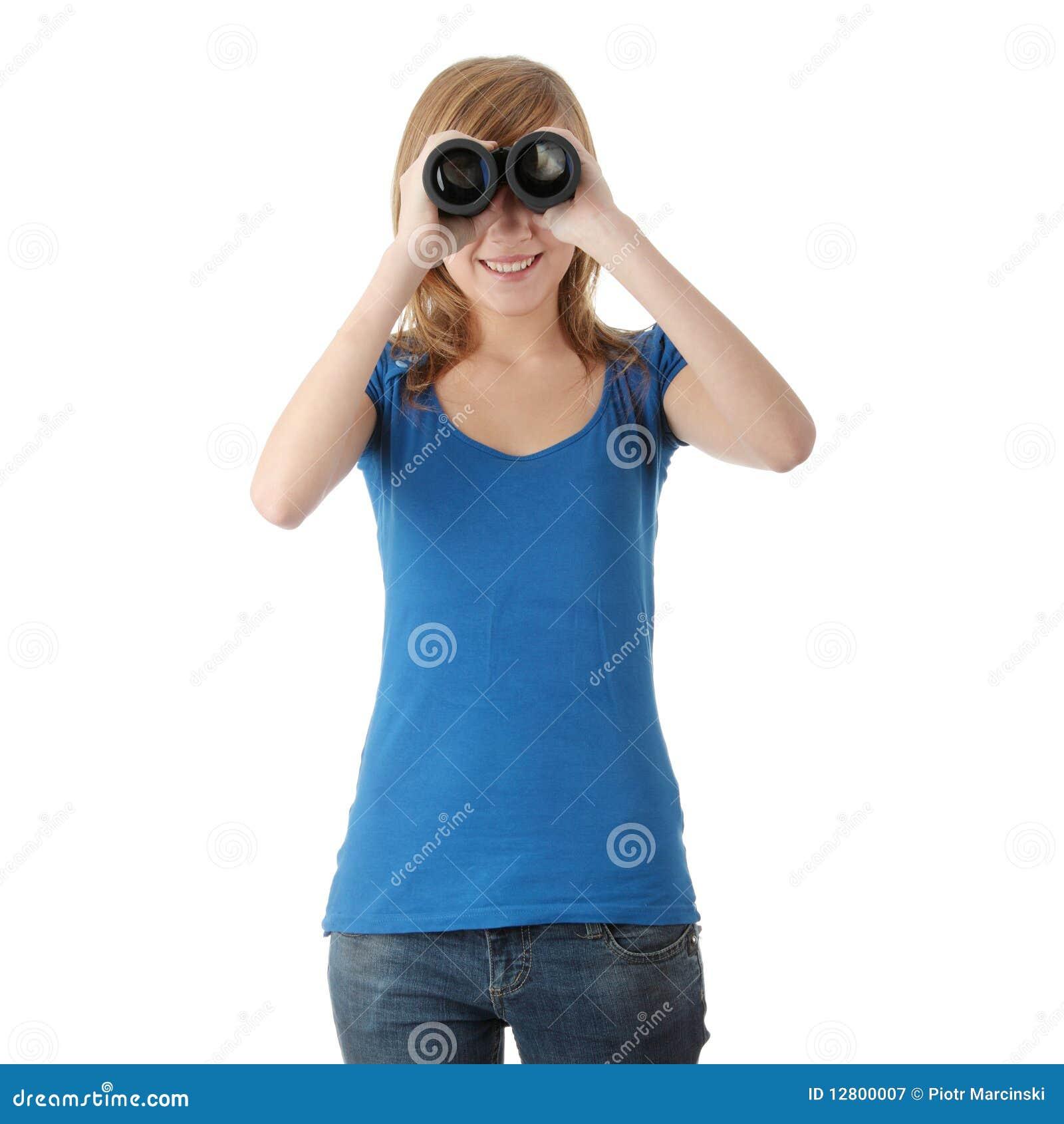 Menina adolescente com binocular