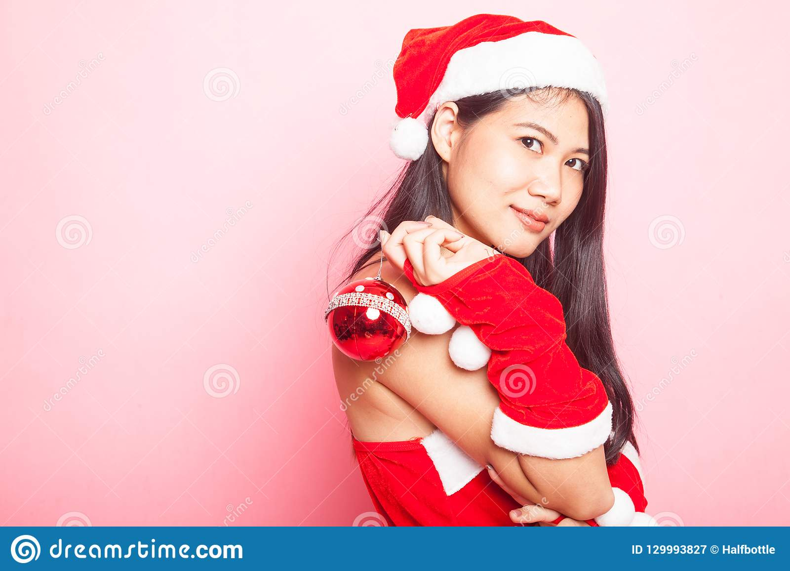Menina asiática bonito de Santa Claus do Natal