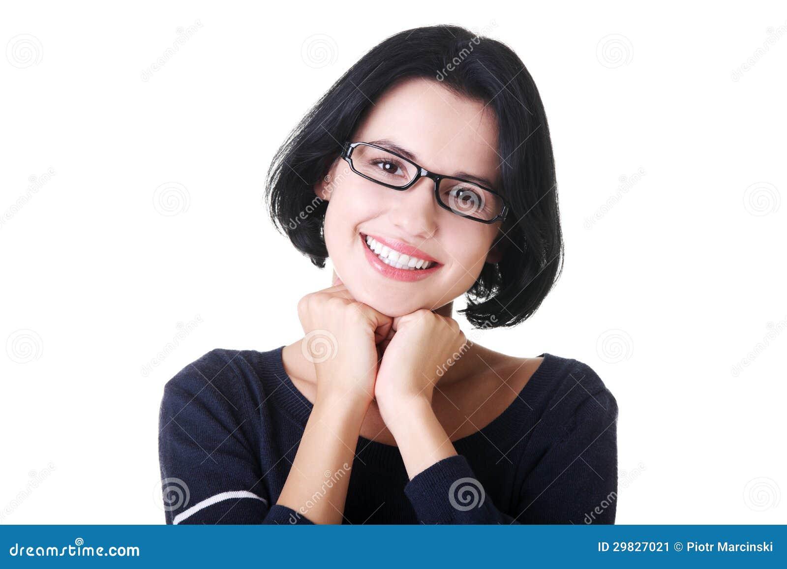 Menina de sorriso do estudante na roupa ocasional