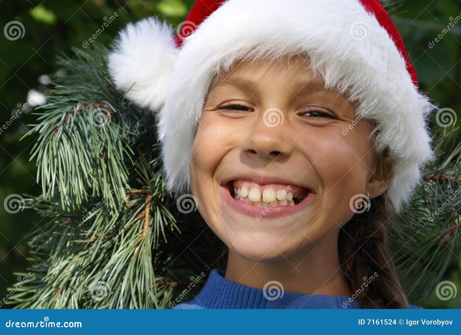 Menina do Preteen no chapéu de Santa