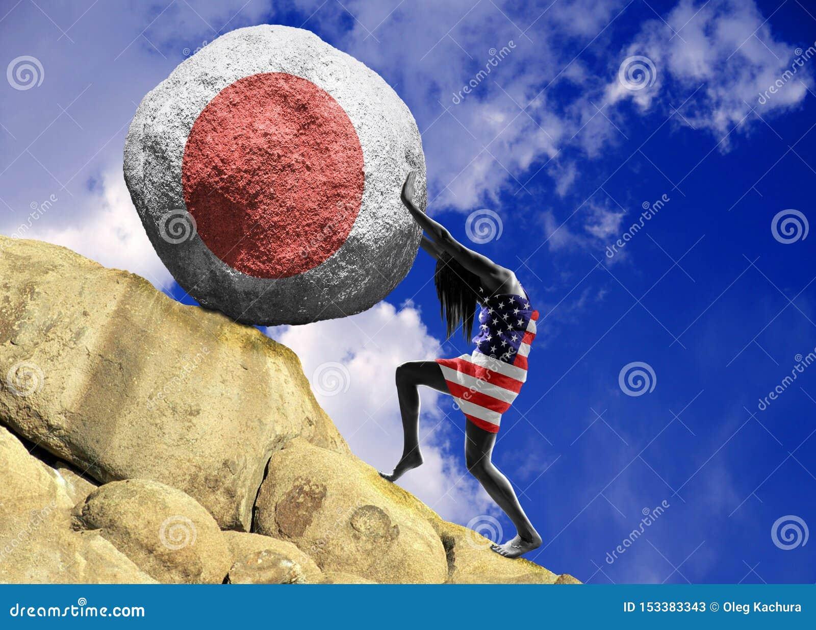A menina, envolvida na bandeira do Estados Unidos da América, aumenta uma pedra para a parte superior sob a forma da silhueta da