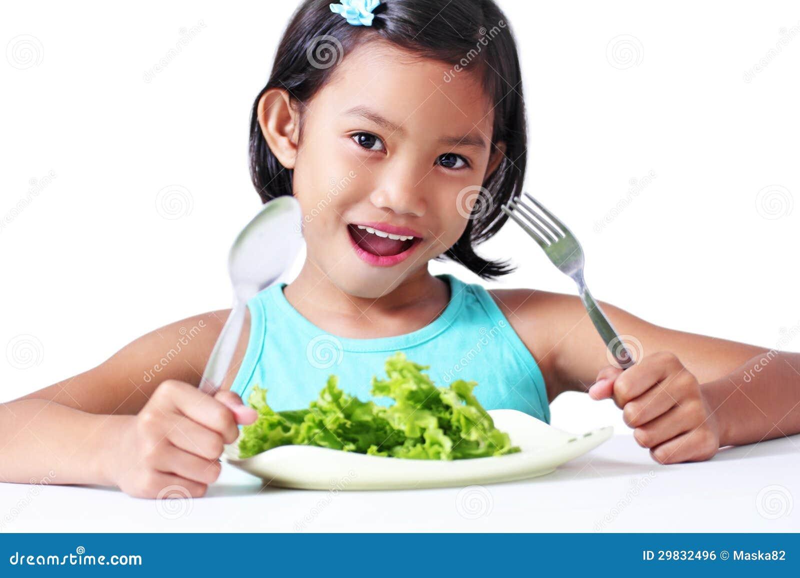 Menina com vegetal