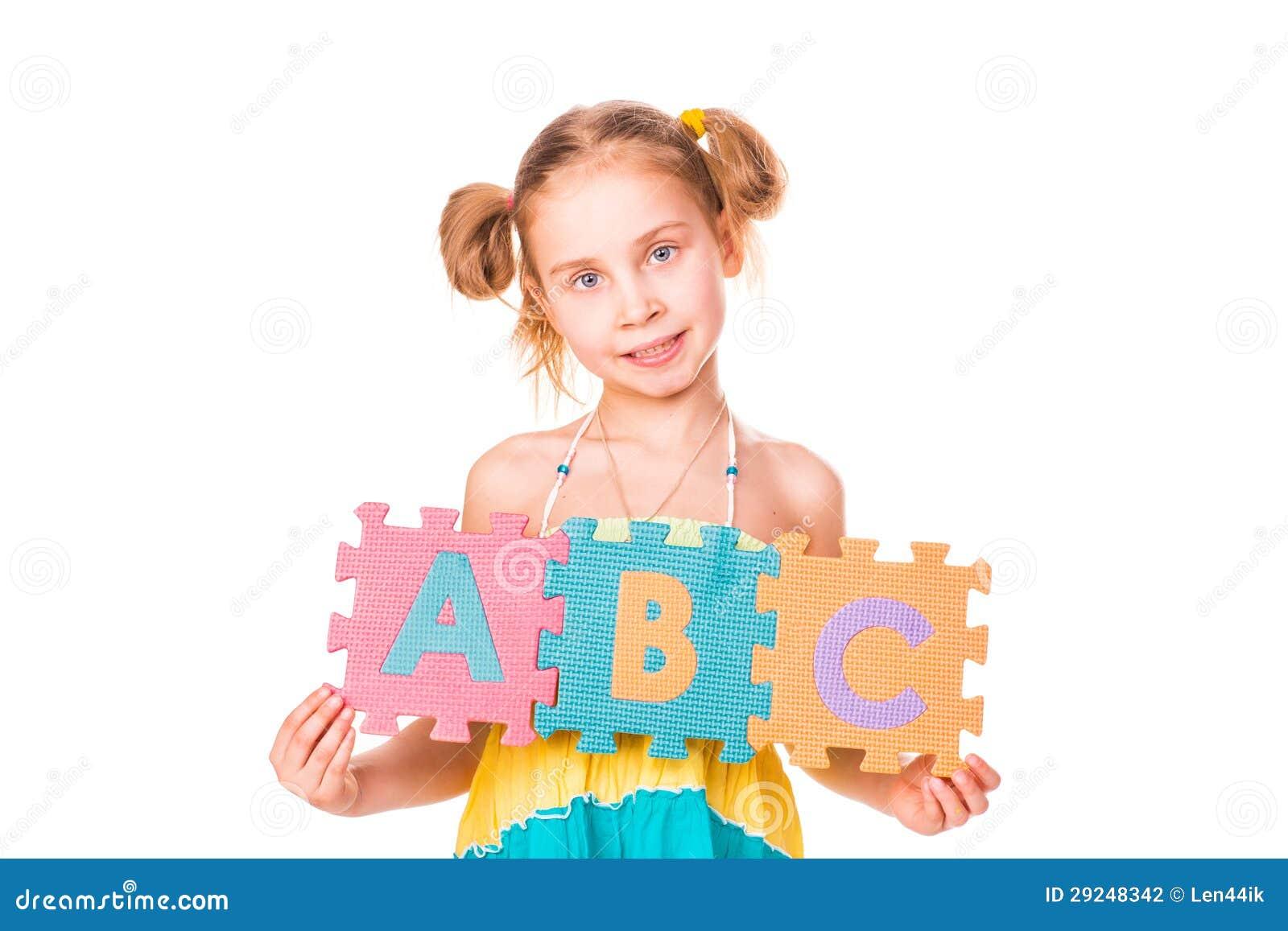 Download A Menina Feliz Que Guardara O Alfabeto Rotula ABC Foto de Stock - Imagem de face, menina: 29248342