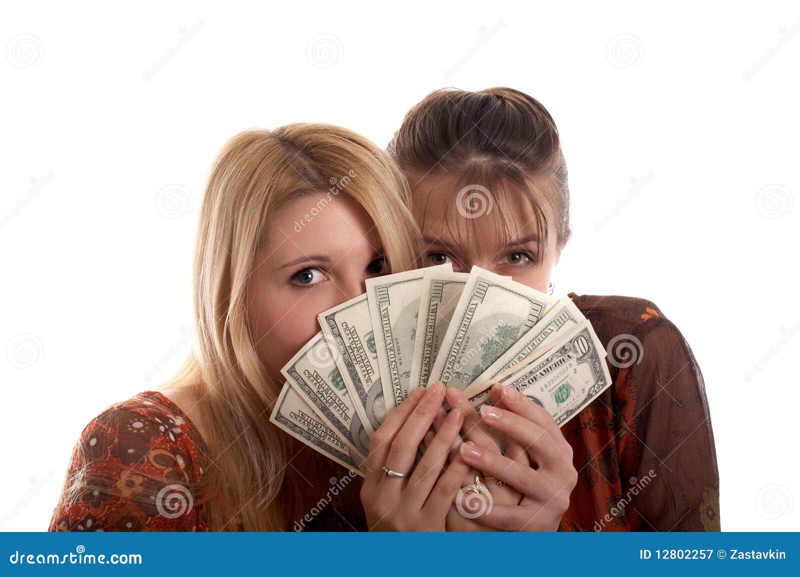 Meninas com dinheiro nas mãos