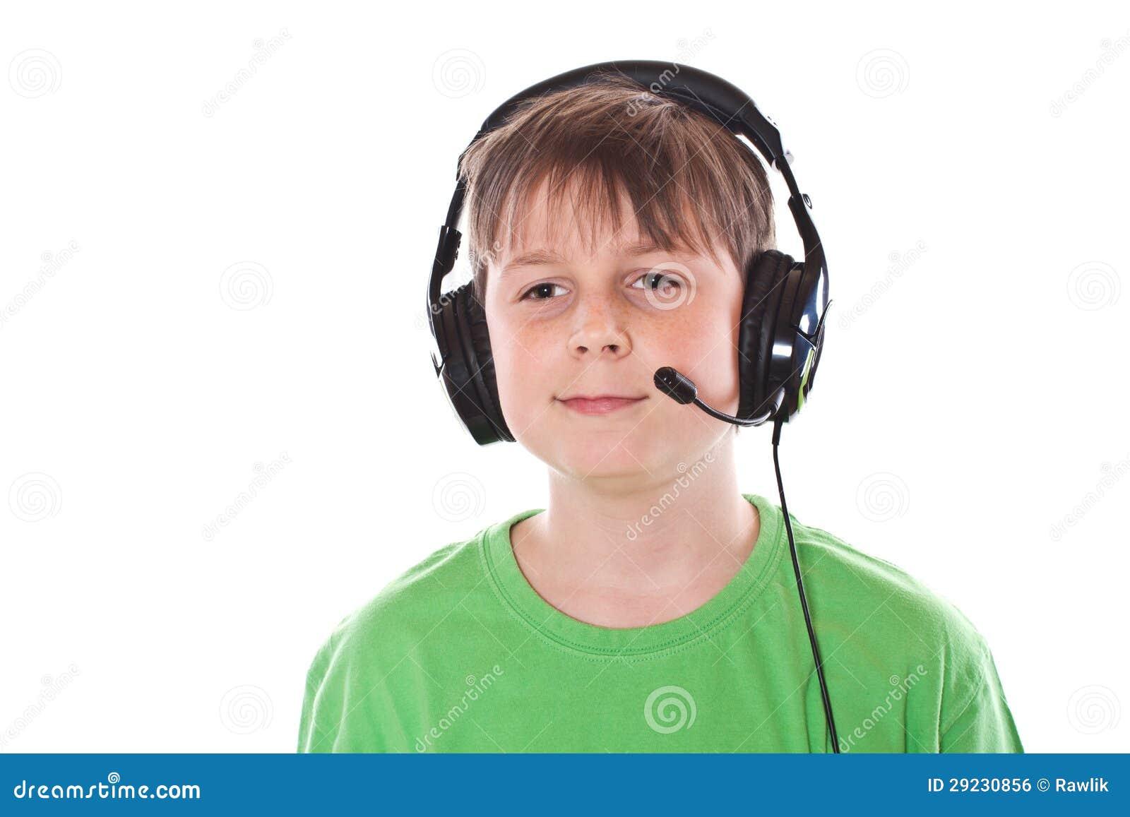Download Menino Que Escuta A Música Com Auscultadores Foto de Stock - Imagem de idade, schoolboy: 29230856