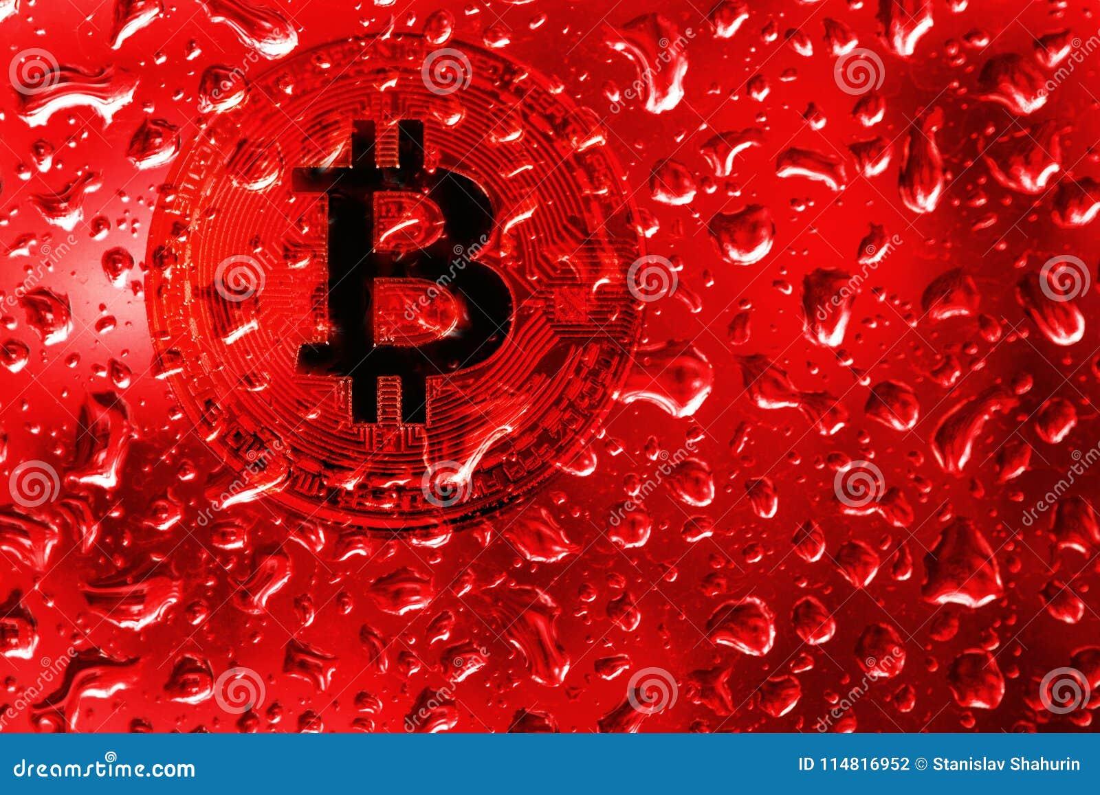 Menniczy bitcoin za szkłem z czerwonymi kroplami