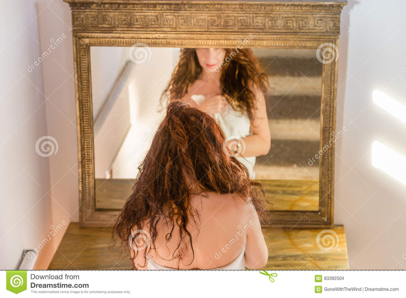 Menopausal woman in antique mirror royalty free stock for Long body mirror