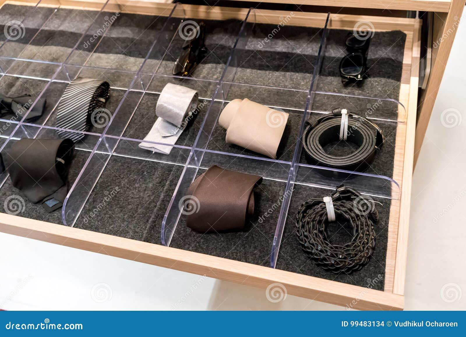 Mens accessories in closet drawer