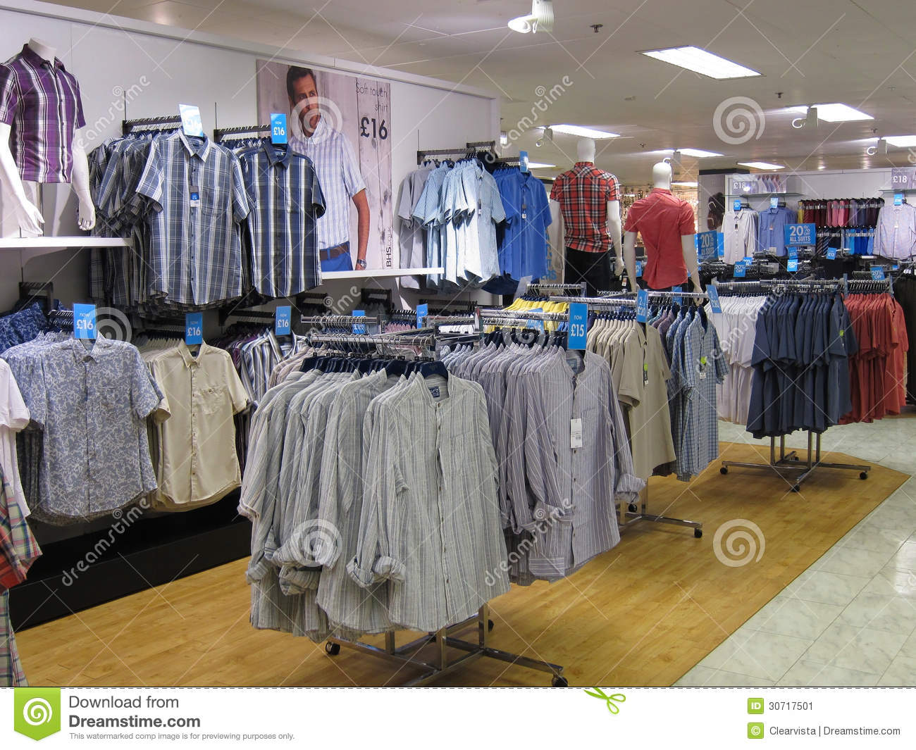 inside of a mans clothing store displaying mainly shirts. This store