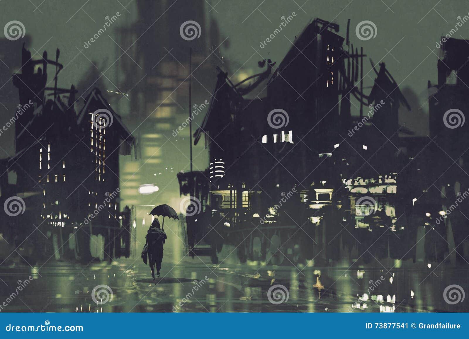 Mens die met paraplu in donkere stad bij nacht lopen