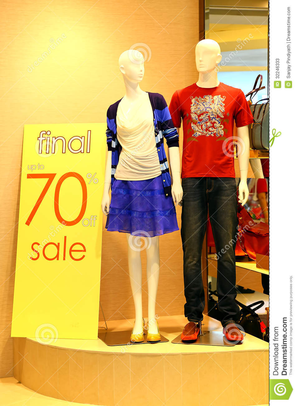 clothes for men and women on display at a store with price discount
