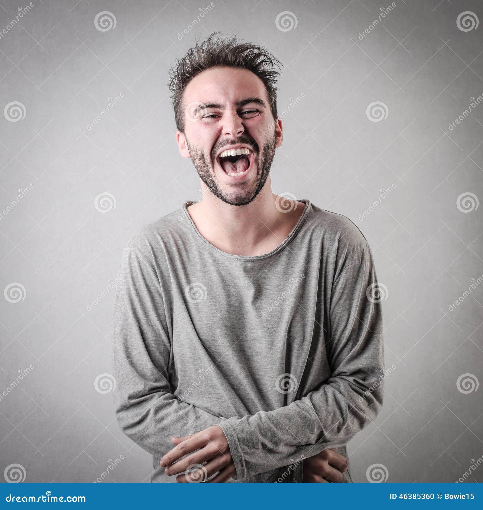 Mens luid lachen uit