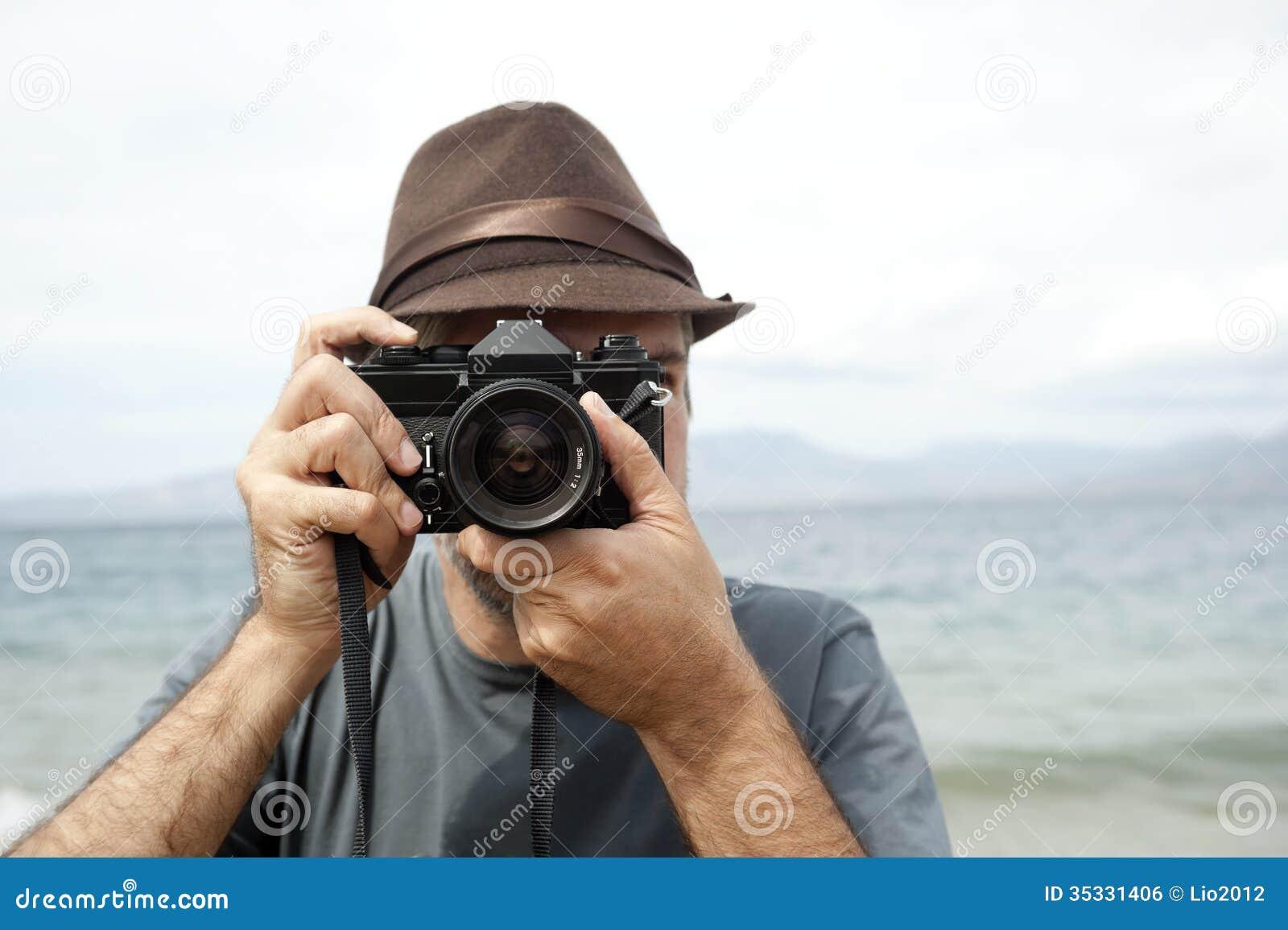 Mens met camera