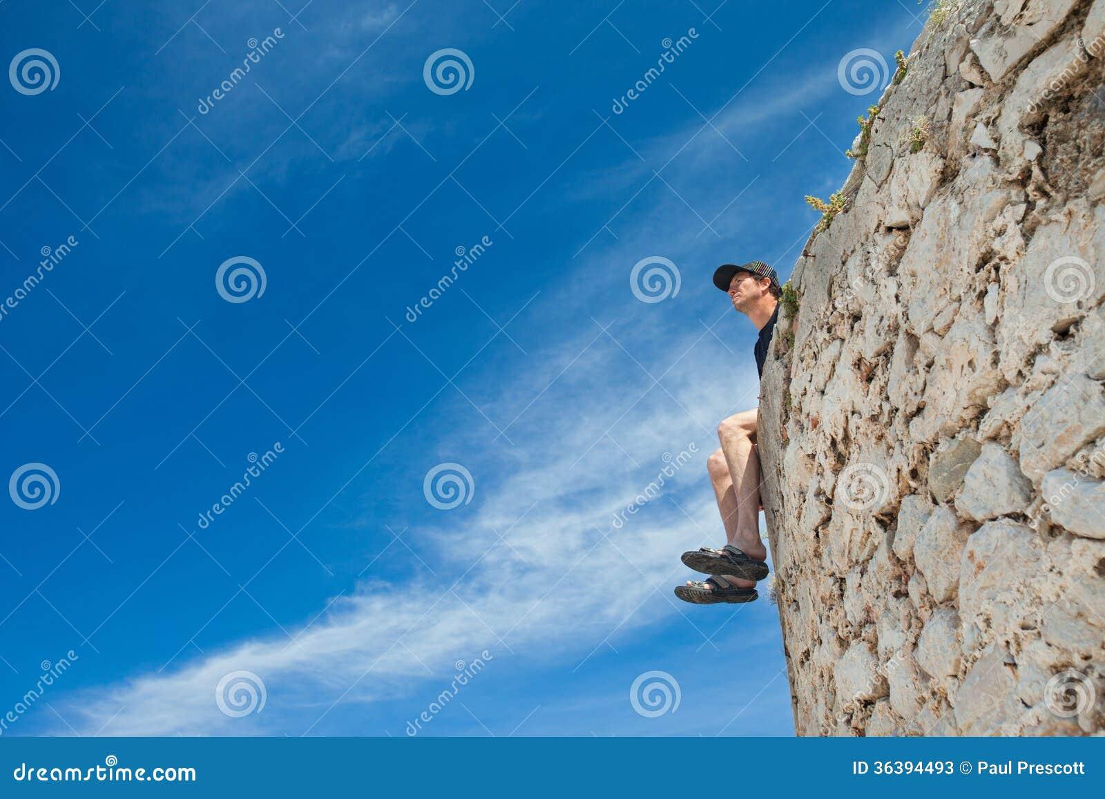 Mens op muur