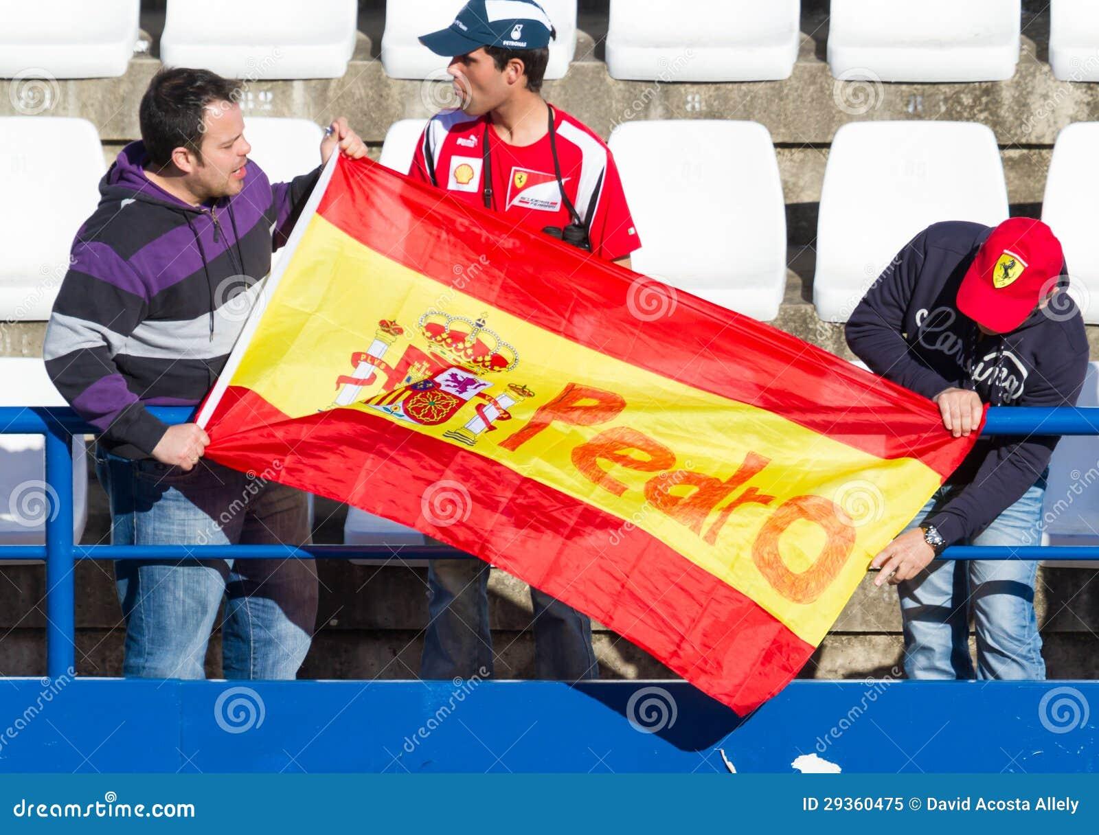 Mensen die de opleiding van Formule 1, 2013 zien