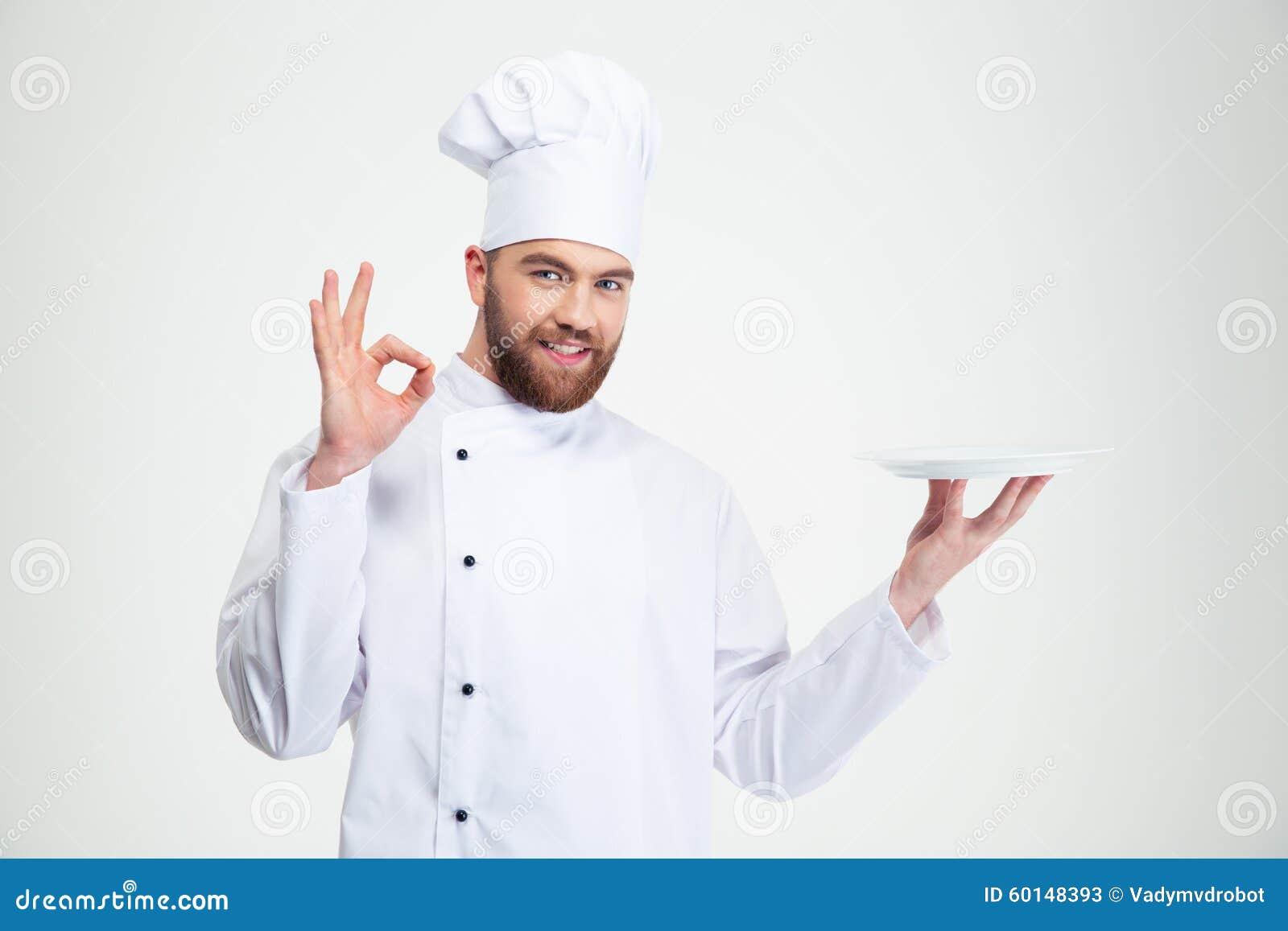 Mensenchef-kok die o.k. teken en lege plat tonen