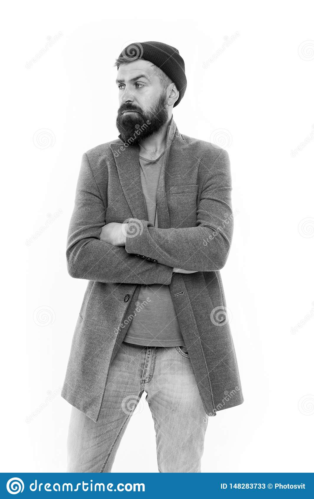Menswear and fashion concept. Man bearded hipster stylish fashionable coat and hat. Stylish outfit hat accessory. Pick