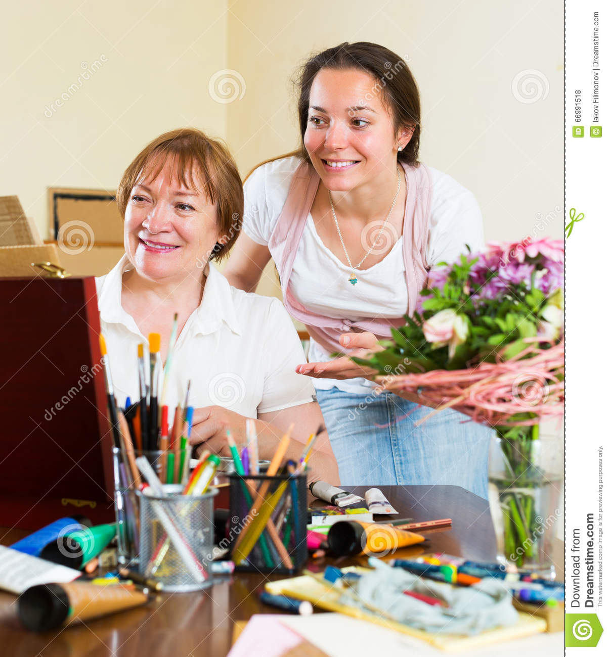 mentor assesses the work student stock photo image 66991518 mentor assesses the work student