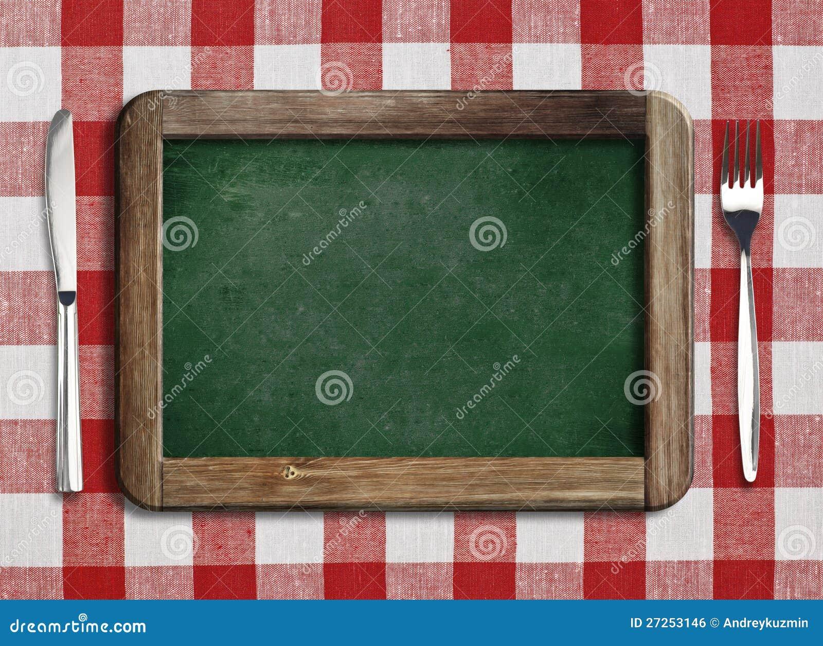 Menu blackboard lying on the beach na stole