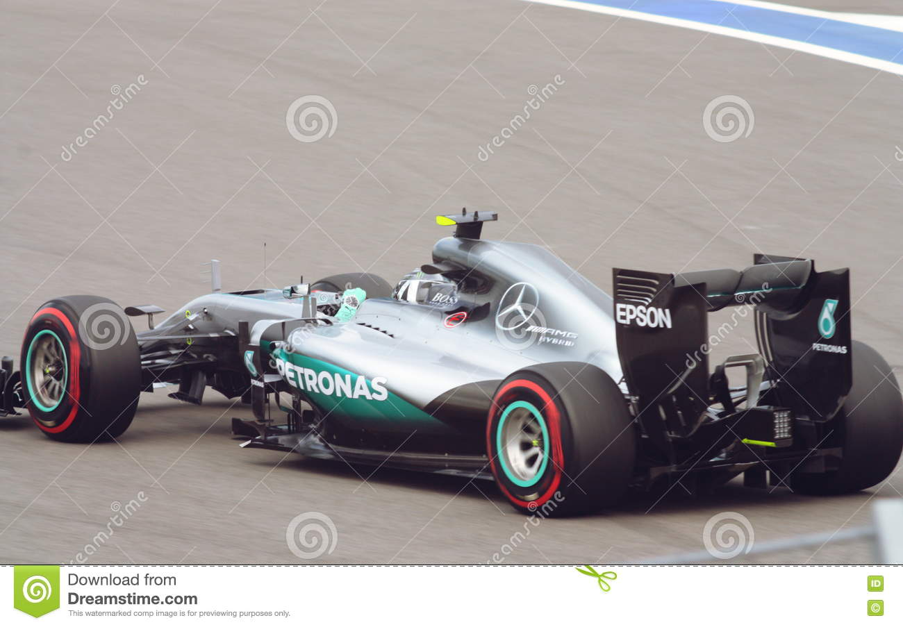 809fccf8b2c Nico Rosberg of Mercedes AMG Petronas F1 Team on the racetrack. Back view  in motion at high gear . Race car tires supersoft red colour coding