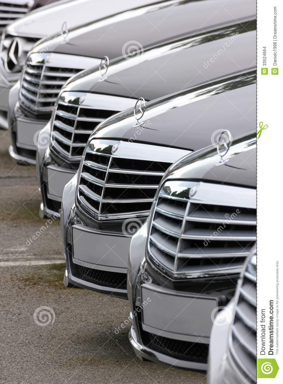 Mercedes Benz cars lined up