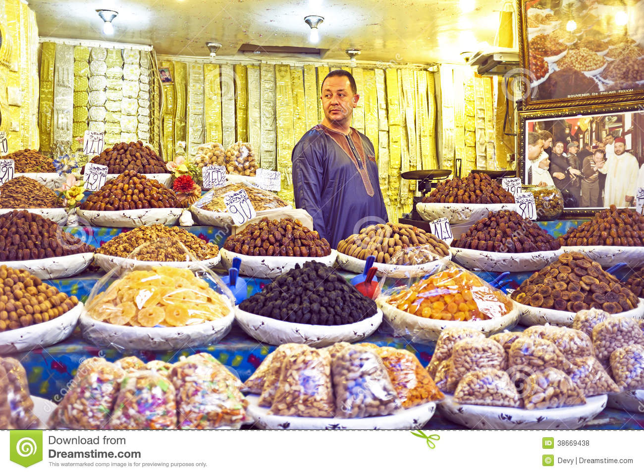 Fes marocco october 17 2013 merchant is selling dried fruits and