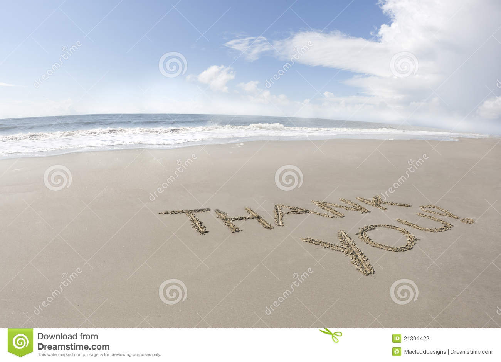 Merci écrit sur une plage