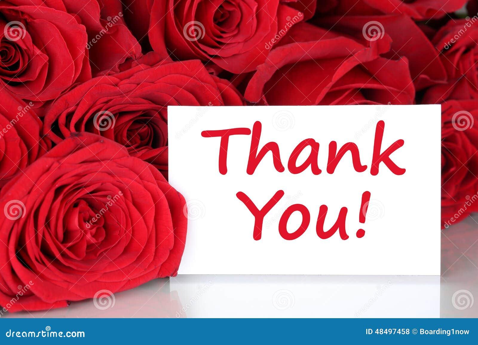 Merci carder avec des fleurs de roses rouges