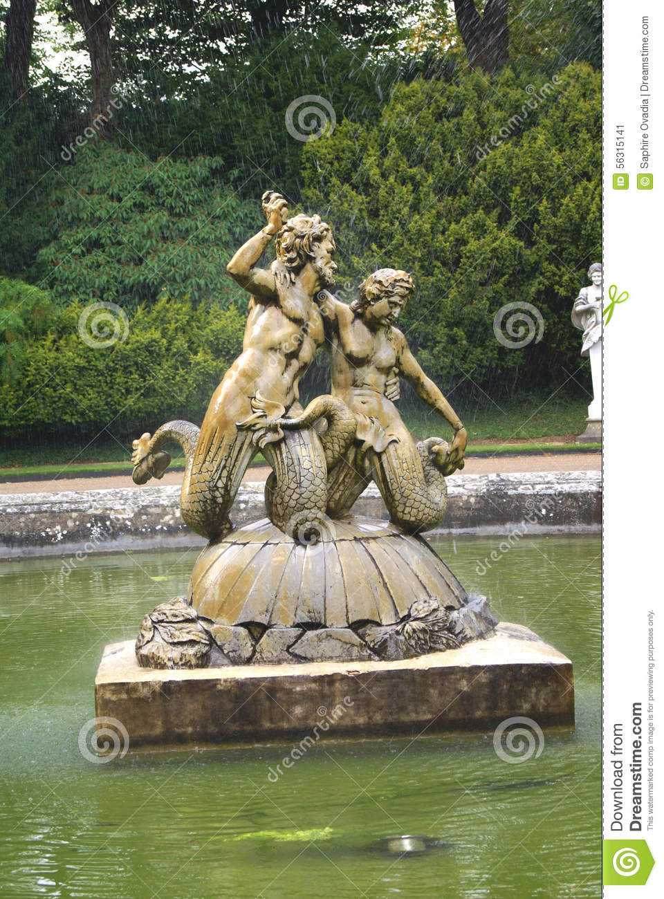 Mermaid Fountain At A Garden In England, Europe