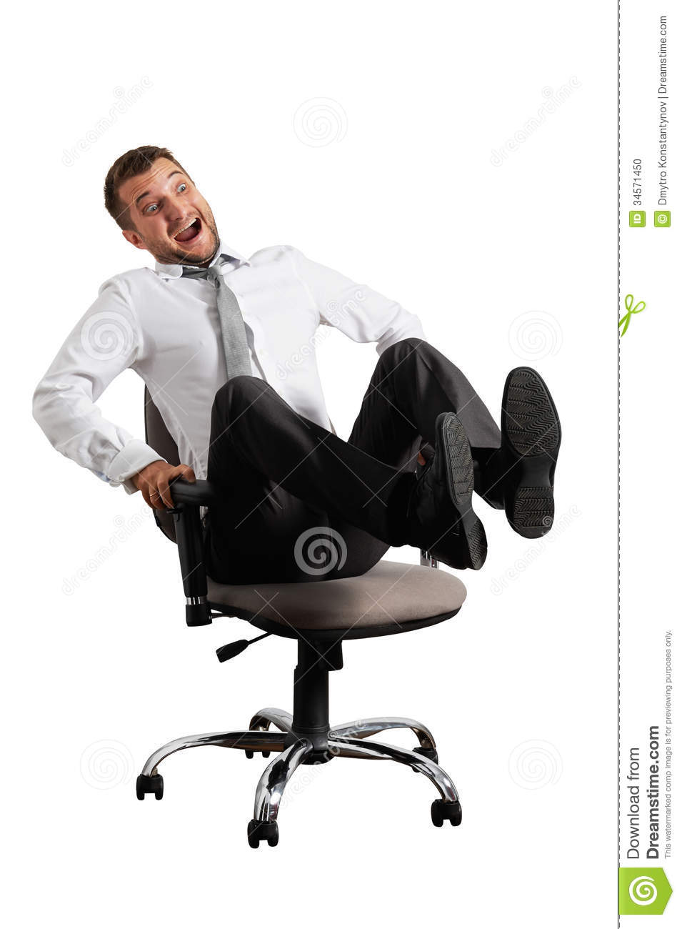Merry Businessman Rolling On The Office Chair Stock Photo