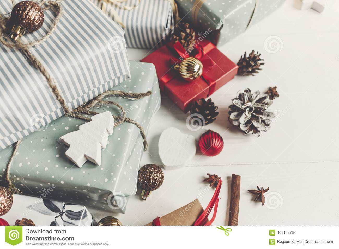 Merry christmas concept. present boxes with ornaments tree cones