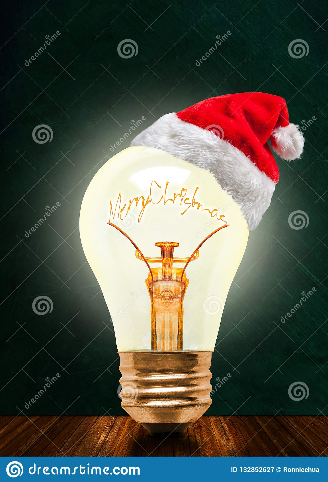 Merry Christmas Glowing Light Bulb With Santa Hat And Copy Space