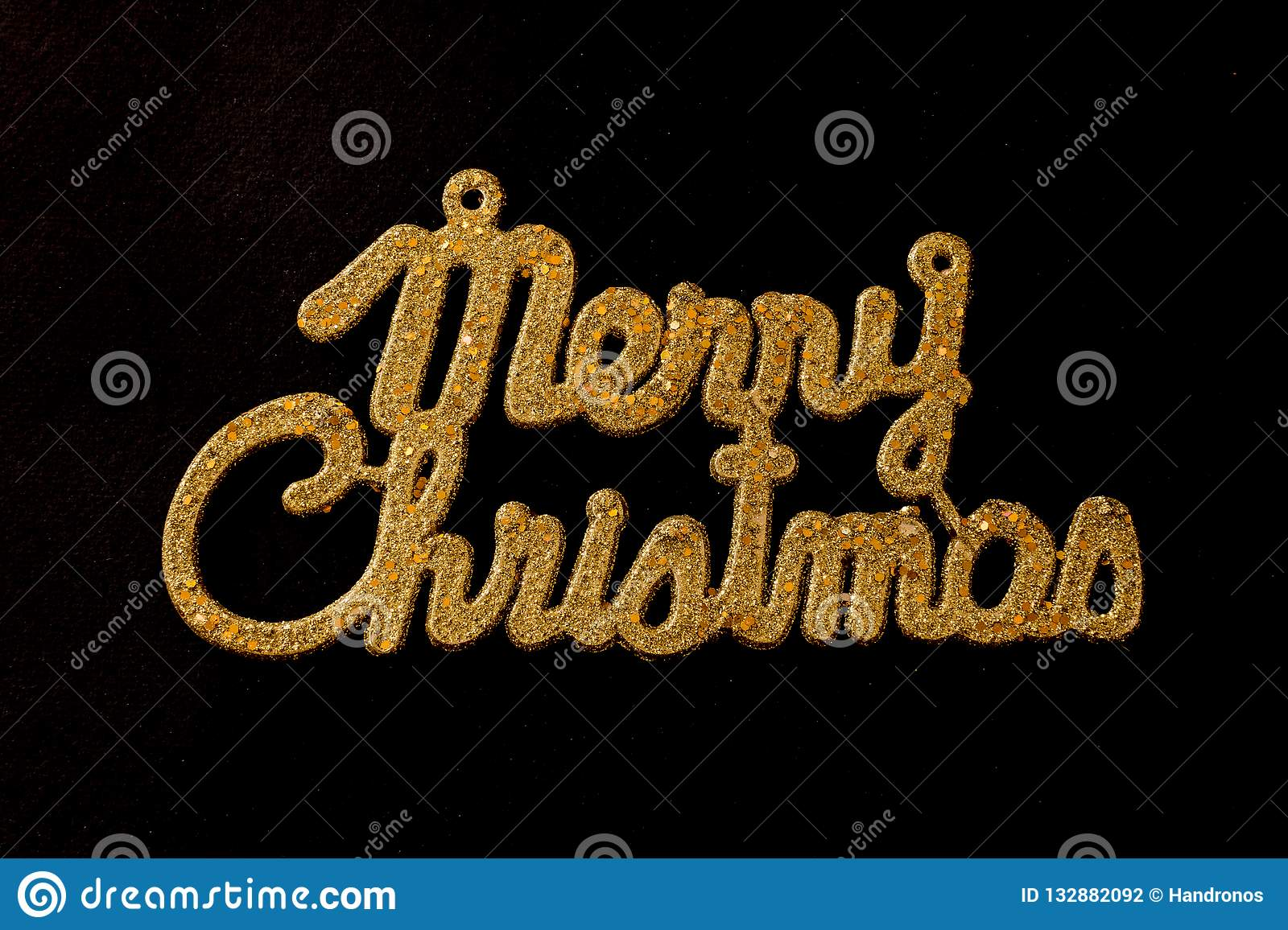 Merry Christmas golden text on a black background