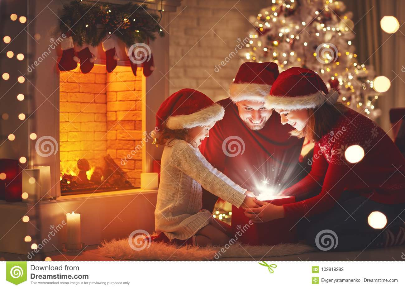 Merry Christmas! happy family mother father and child with magic