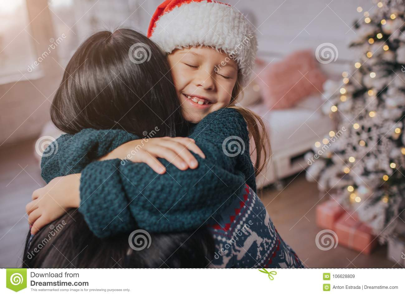 Download Merry Christmas And Happy Holidays Cheerful Mom Her Cute Daughter Girl Exchanging Gifts