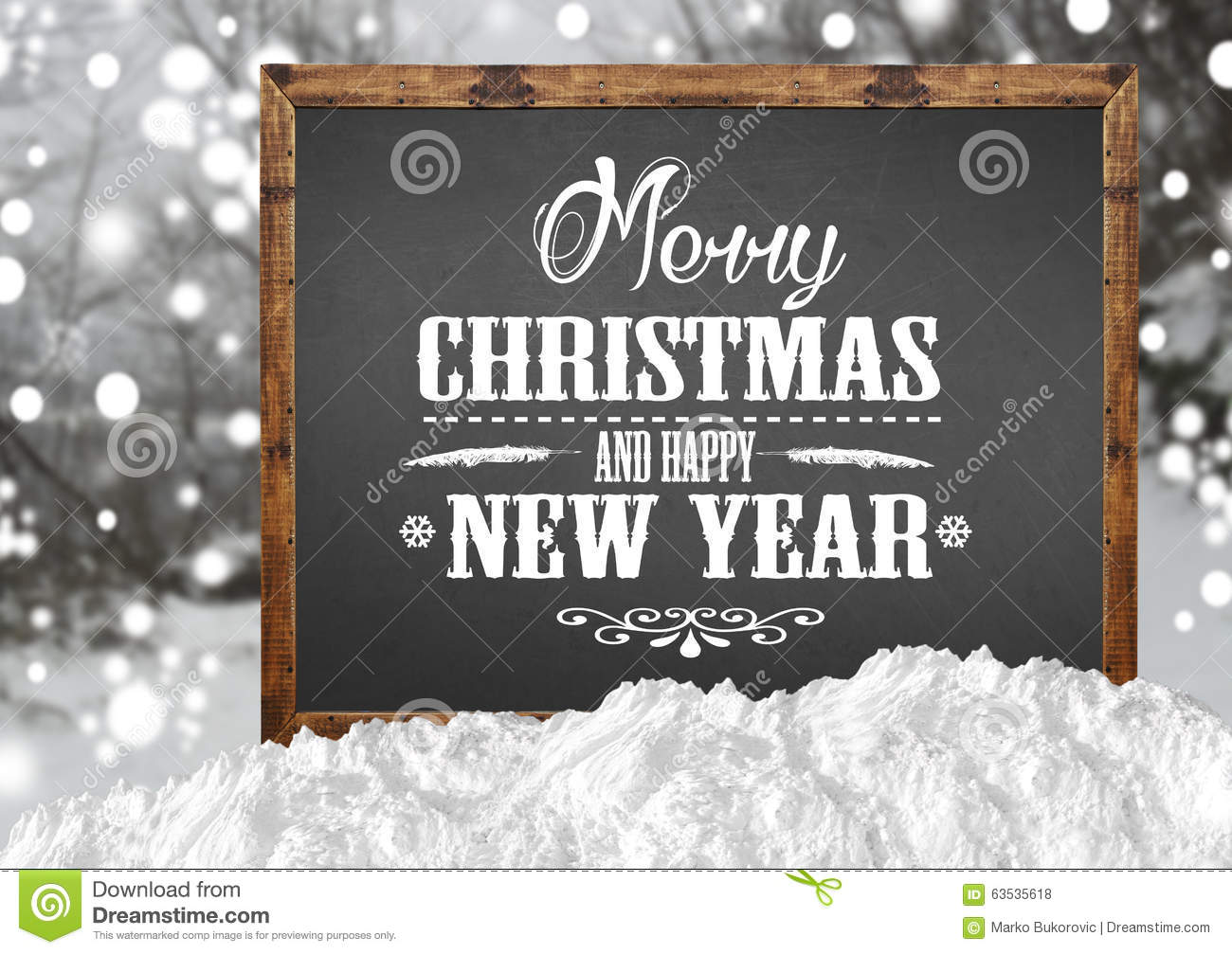 merry christmas and happy new year on blank blackboard with blur forest with snow