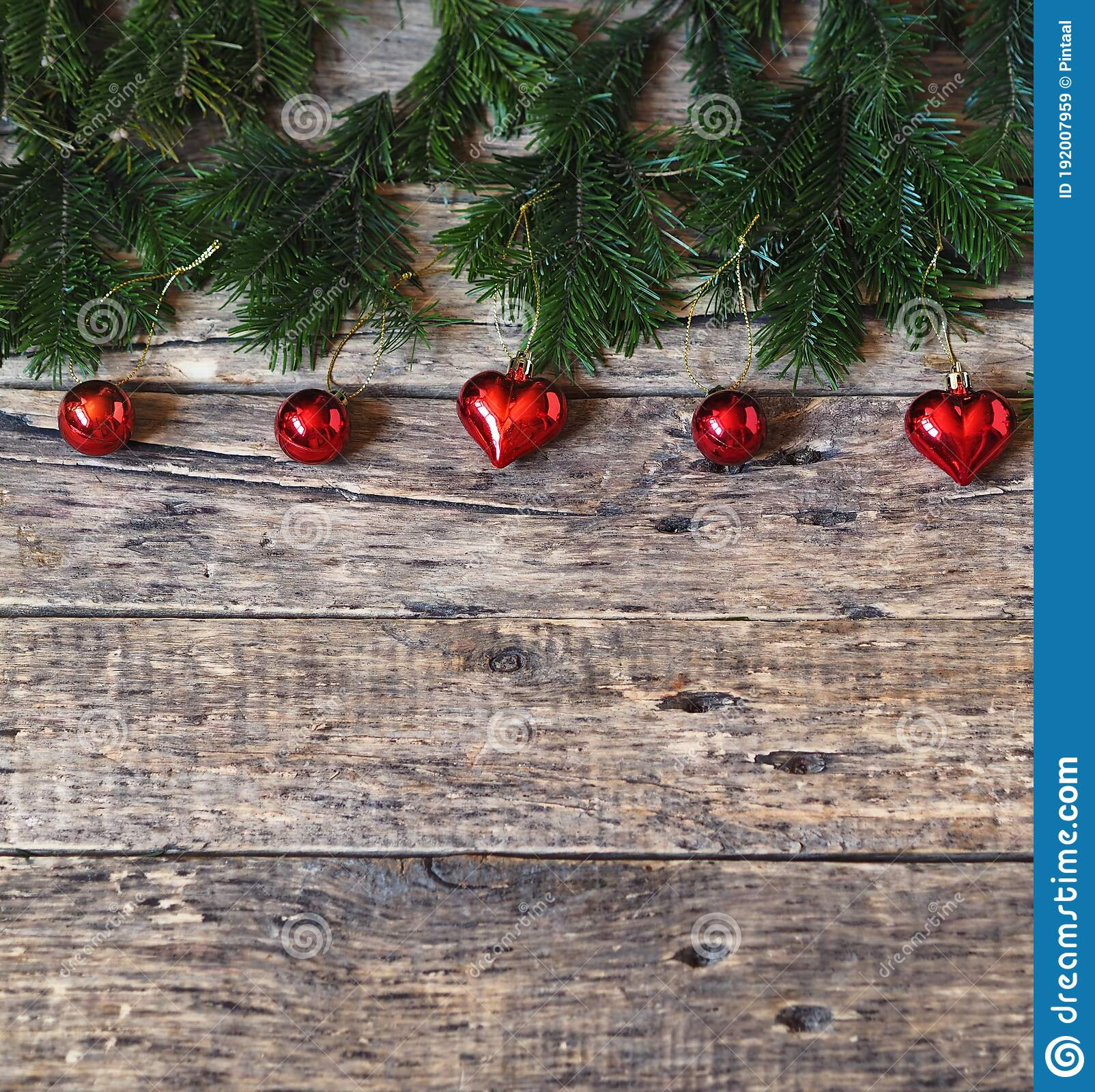 Merry Christmas And Happy New Year Spruce Branches With Christmas Tree Decorations Are Laid Out On A Natural Wooden Background Stock Image Image Of Branch Border 192007959
